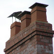 A collection of chimney pots