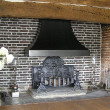 A grey brick fireplace